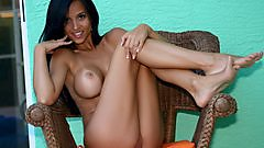 Janessa Brazil chilling naked in her patio chair.