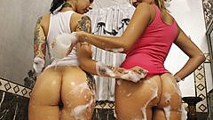 EVE and her friend get soapy together.