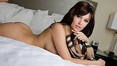 Liz Asset lays around naked with her burberry scarf.