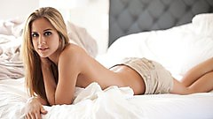 Cassidy Cole takes off her blue sweater and lays around naked.